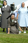 Sr. Catherine Veierstahler, a Sister of Charity of St. Joan Antida, falls to the ground after tossing a bocce ball during a bocce tournament held during the annual St. Joan Antida High School reunion, held July 22 at the Henry Meier Festival Grounds in Milwaukee. (Photo by Sam Lucero)