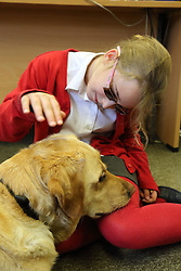 Portrait of young girl with visual impairment, and guide dog, Mysight Nottingham