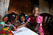 Sidonie at home with family drawing a picture of the Nurses that helped her in 2011. <br /> <br /> Follow up visit to see Sidonie Haritiana (Patient No 074) who received surgery for her Unilateral Cleft Lip during Operation Smile&rsquo;s 2011 mission to Antananarivo when she was 7 years old. <br /> <br /> Sidonie is now 9 years old and lives with her Father Patrick, Mother Harinirima, Older Sister Chantale and younger sister Jafia. In a one room hut they rent near the brickworks which her mother and father work in. Sidonie attends school but as she is on summer holidays she helps her mother and father at work in the brick works.<br /> <br /> Outskirts of Antananarivo. Madagascar. 25th August 2014.<br /> <br /> (Operation Smile Photo - Zute Lightfoot)
