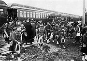 Canadian regiment of 'Highlanders' in traditional uniform of kilt, sporran and Glengarry bonnet, arriving by train at their moblization camp at Valcartier.