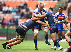 Cape Town-180427 stomers right lock Pieter Steph du Toit tackled by Michael Ruru and Adam Coleman in the Super 15 rugby game at Newlands Stadium.photograph:Phando Jikelo/African news Agency