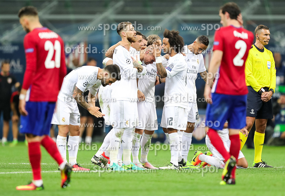 Sergio Ramos of Real Madrid, Pepe of Real Madrid, Marcelo of Real Madrid before last penalty shot of Cristiano Ronaldo of Real Madrid during penalty shots at football match between Real Madrid (ESP) and Atlético de Madrid (ESP) in Final of UEFA Champions League 2016, on May 28, 2016 in San Siro Stadium, Milan, Italy. Photo by Vid Ponikvar / Sportida