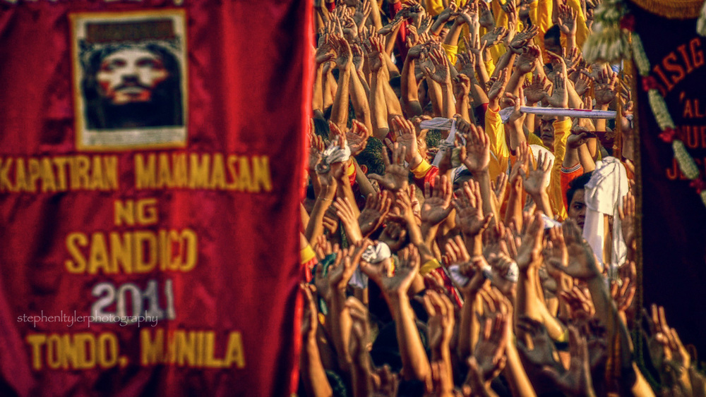 Hands reaching for the heavens in celebration of the Feast of the Black Nazarene.