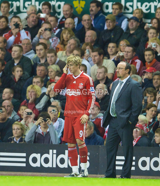 LIVERPOOL, ENGLAND - Tuesday, September 23, 2008: Liverpool's manager Rafael Benitez gives some last minute advice to Fernando Torres before coming on as a substitute against Crewe Alexandra during the League Cup 3rd round match at Anfield. (Photo by David Rawcliffe/Propaganda)