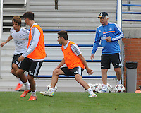 Football - Real Madrid Training for St. Louis Game against Inter Milan.  The Real Madrid team held a practice session on Thursday August 8, 2013 in St. Louis, Missouri, USA at the Robert Hermann Stadium located on the campus of St. Louis University in St. Louis.  Head Coach Carlo Ancelotti (right, with cap) watches training scrimmages.