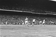 Players run towards the ball downfield during the All Ireland Senior Gaelic Football Championship Final Kerry v Dublin at Croke Park on the 22nd September 1985. Kerry 2-12 Dublin 2-08.