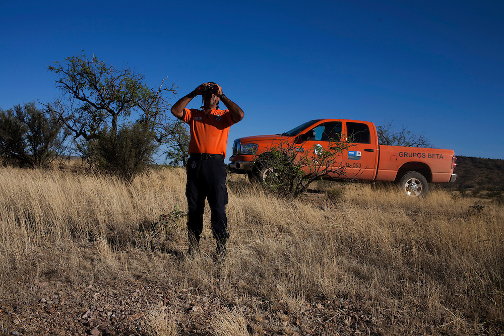 Members of Grupo Beta, a Mexican government organization that works to help migrants, searches for a man who has gone missing from his group and is believed to be lost in the desert.