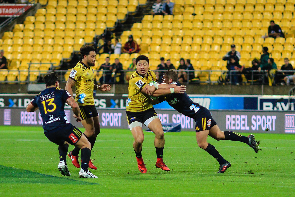 Ben Lam  tackled during the super rugby union  game between Hurricanes  and Highlanders, played at Westpac Stadium, Wellington, New Zealand on 24 March 2018.  Hurricanes won 29-12.
