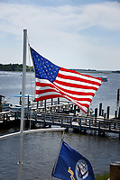 The American flag flaps in the fall breeze alongside the White Oak River in Swansboro.