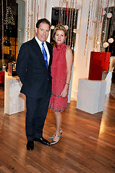 VISCOUNT & VISCOUNTESS LINLEY at the Linley Christmas Party held at Linley, 60 Pimlico Road, London on 16th November 2011.