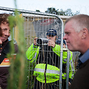 The police Forward Intelligence Team(FIT) record a conversation between fellow anti-fracking activists next to the Cuadrilla fracking site. Thousands turned out for a march of solidarity against fracking in Balcombe. The village Balcombe in Sussex is the  centre of fracking by the company Cuadrilla. The march saw anti-fracking movements from the Lancashire and the North, Wales and other communities around the UK under threat of gas and oil exploration by fracking.