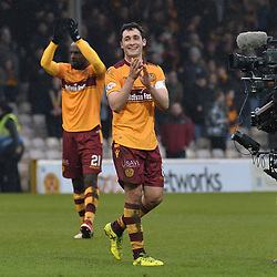 Carl McHugh (Motherwell) salutes the Motherwell fans at full time after scoring the winner in the Scottish Cup quarter final between Motherwell and Hearts at Fir Park, where the home side made it into the semi final draw with a win.<br /> <br /> <br /> (c) Dave Johnston | sportPix.org.uk