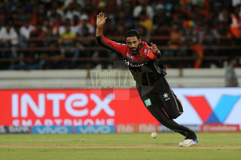 Sreenath Arvind of the Royal Challengers Bangalore tries to filed of his own bowling during match 20 of the Vivo 2017 Indian Premier League between the Gujarat Lions and the Royal Challengers Bangalore  held at the Saurashtra Cricket Association Stadium in Rajkot, India on the 18th April 2017<br /> <br /> Photo by Vipin Pawar - Sportzpics - IPL