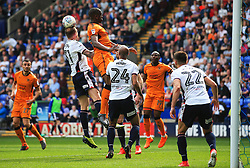 David Wheater of Bolton Wanderers clears from a corner under pressure from Benik Afobe of Wolverhampton Wanderers - Mandatory by-line: Matt McNulty/JMP - 21/04/2018 - FOOTBALL - Macron Stadium - Bolton, England - Bolton Wanderers v Wolverhampton Wanderers - Sky Bet Championship