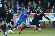 AFC Wimbledon striker Andy Barcham (17) battles with Portsmouth defender Christian Burgess (6) during the Sky Bet League 2 match between AFC Wimbledon and Portsmouth at the Cherry Red Records Stadium, Kingston, England on 26 April 2016.