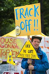 © London News Pictures. 27/07/2013. Balcombe, UK.  Anti Fracking activists and local villagers attempt to blockade a lorry entering a drilling site in Balcombe, West Sussex which has been earmarked for fracking. A number of demonstrators at the site have been arrested. Photo credit: Ben Cawthra/LNP