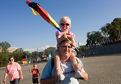 German family at south entrance of the stadium during day two of the 12th 2009 IAAF Athletics World Championships on August 16, 2009 in Berlin, Germany. (Photo by Vid Ponikvar / Sportida)
