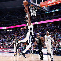 01 April 2018: Denver Nuggets forward Will Barton (5) is blocked by Milwaukee Bucks forward Khris Middleton (22) during the Denver Nuggets 128-125 victory over the Milwaukee Bucks, at the Pepsi Center, Denver, Colorado, USA.