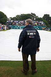 Liverpool, England - Wednesday, June 13, 2007: Tournament Referee Alan Mills inspects the rain covers on centre court during day two of the Liverpool International Tennis Tournament at Calderstones Park. (Pic by David Rawcliffe/Propaganda)
