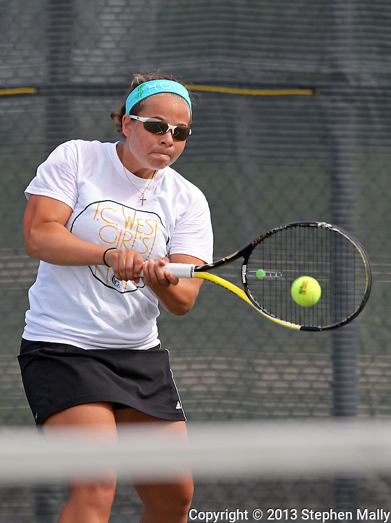 Iowa City West's Elena Wilson powers back a return during the Class 2A state team tennis tournament at Veterans Memorial Tennis Center in Cedar Rapids on Saturday, June 1, 2013.