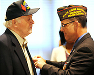 World War II Veteran, Robert K. Patterson (left) is presented with the Bronze Star Medal by State Director, Bob DeSousa (right), COL USAR JA at the Horsham Township Building Friday August 7, 2015 in Horsham, Pennsylvania. (Photo by William Thomas Cain)