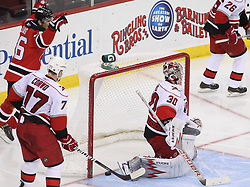 Feb 16; Newark, NJ, USA; The New Jersey Devils celebrate a goal by New Jersey Devils left wing Brian Rolston (12) on Carolina Hurricanes goalie Cam Ward (30) during the third period at the Prudential Center. The Devils defeated the Hurricanes 3-2.