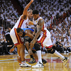 Jun 17, 2012; Miam, FL, USA; Oklahoma City Thunder guard James Harden (13) gets tangled with Miami Heat power forward Udonis Haslem (right) and small forward Shane Battier (left) during the first quarter in game three in the 2012 NBA Finals at the American Airlines Arena. Mandatory Credit: Derick E. Hingle-US PRESSWIRE