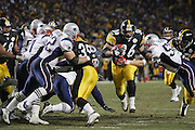 PITTSBURGH - JANUARY 23:  Running back Jerome Bettis #36 of the Pittsburgh Steelers runs for a five yard touchdown in the third quarter while avoiding tackles by linebackers Ted Johnson #52 and Mike Vrabel #50 of the New England Patriots during the AFC Championship game at Heinz Field on January 23, 2005 in Pittsburgh, Pennsylvania. The Pats defeated the Steelers 41-27. ©Paul Anthony Spinelli  *** Local Caption *** Jerome Bettis; Ted Johnson; Mike Vrabel