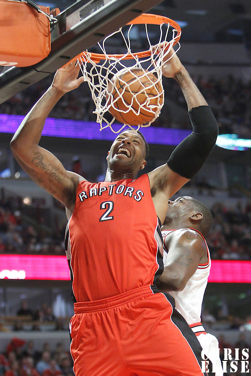 24 March 2012: Toronto Raptors small forward James Johnson (2) dunks on an offensive rebound past Chicago Bulls shooting guard Ronnie Brewer (11) during the Chicago Bulls 102-101 victory in overtime over the Toronto Raptors at the United Center, Chicago, Illinois, USA.