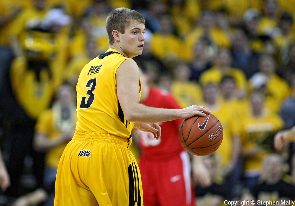 January 27, 2010: Iowa guard Cully Payne (3) looks back towards the bench as he brings the ball down court during the first half of their game at Carver-Hawkeye Arena in Iowa City, Iowa on January 27, 2010. Ohio State defeated Iowa 65-57.