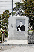 """Tokyo, April 10 2014 -  In front of the Yushukan, Yasukuni shrine's war museum, a portrait of Radhabinod Pal, the Indian jurist who participated in the International Military Tribunal in Tokyo that was held to prosecute war criminals in World War II, and the stone was erected in his honor.<br /> <br /> """"Pal perceived that the Tokyo Trials were little more than a barbarian desire for revenge that the Allies, who were drunk with victory, foisted upon Japan, which had been rendered helpless by its defeat in the war,"""" the stone reads."""