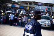 A police officer watches over the crowd during the annual Oguaa Fetu Afahye Festival in Cape Coast, Ghana on Saturday September 6, 2008.