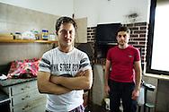 Verbicaro, Italia - 4 giugno 2011. Stefano Torrano (sinistra) e suo fratello Davide, ritratti all'interno della cucina abbandonata del loro ristorante. Il ristorante era stato avviato dal padre che aveva investito i risparmi di una vita. Stefano e Davide Torrano sono attualmente disoccupati..Ph. Roberto Salomone Ag. Controluce