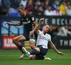 Kemar Roofe of Leeds United (L) and Andrew Taylor of Bolton Wanderers collide during the match - Mandatory by-line: Jack Phillips/JMP - 06/08/2017 - FOOTBALL - Macron Stadium - Bolton, England - Bolton Wanderers v Leeds United - English Football League Championship