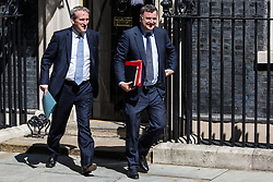 London, UK. 23 July, 2019. Mel Stride MP, Lord President of the Council and Leader of the House of Commons, and Damian Hinds MP, Secretary of State for Education, leave 10 Downing Street following the final Cabinet meeting of Theresa May's Premiership. The name of the new Conservative Party Leader, and so the new Prime Minister, is to be announced at a special event afterwards.