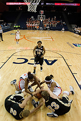 UVA's Monica Wright (22) and Siedah Williams (4) fight with Wake Forest's Alex Tchangoue (2) and Corienne Groves (33) for a loose ball.  The Cavaliers defeated the Demon Deacon 77-71 on January 11, 2007 for their first ACC win in the John Paul Jones Arena in Charlottesville, VA.<br />