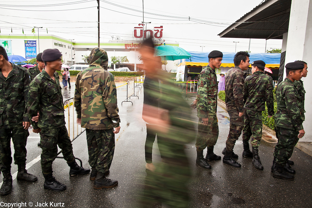26 JUNE 2011 - CHIANG MAI, THAILAND:   Royal Thai Army soldiers wait to cast their absentee ballots in Chiang Mai Sunday. The role of the military in this election has been fiercely debated because the Army command has indicated they would not favor a victory by Pheua Thai, the leading party in this election. Absentee voting was Sunday, July 26 in Thailand's national election. The regular voting is Sunday July 3. In Chiang Mai, center of the powerful Red Shirt opposition movement and their legal party Pheua Thai, turnout was heavy despite a steady rain. Thailand's democracy will be tested in the election, which is the most bitterly fought contest in Thai political history. The Pheua Thai represents people loyal to fugitive former Prime Minister Thaksin Shinawatra, ousted by a military coup in 2006. The ruling Democrats have governed Thailand in one form or another nearly continuously since 1932. Pre-election polls show Pheua Thai leading but not by enough to rule without forming a coalition with smaller parties.    PHOTO BY JACK KURTZ