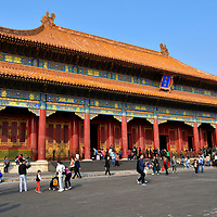 Hall of Supreme Harmony Profile at Forbidden City in Beijing, China<br /> The Hall of Supreme Harmony was used to host lavish ceremonies such as weddings and enthronements. In the Ming dynasty, this is also where the emperor held court. The vermillion fa&ccedil;ade consists of eleven bays with diamond-shaped lattice windows. It is supported by 72 pillars and on the floor are 4,718 tiles. Inside is a sandalwood throne used during the Qing dynasty. It is called the Dragon Throne because the mythical beast was considered the symbol of the emperor&rsquo;s imperial and omnipotent power. Surrounding the throne are more dragon images &ndash; including on the caisson ceiling - showcased among six pillars covered by gilded lacquer. Taihe dian is sometimes referred to as the Hall of Gold Throne.