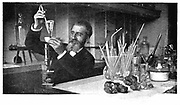 Henri Moissan (1852-1907) French chemist. Moissan recovering diamonds after dissolving the iron surrounding them after final stage in his production of artificial diamonds at the Edison workshops, Paris.  From 'Pearson's Magazine', London, 1900