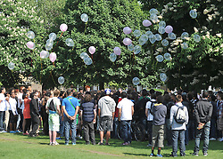 © licensed to London News Pictures. LONDON UK. 25/04/11. Balloons are released. Friends and family gather at a memorial service in a park in Chiswick, London, today (25 April 2011) to remember Isobel Reilly who died after a party in the early hours of Saturday morning. Photo credit should read Stephen Simpson/LNP