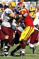 11 October 2008: Arizona Mike Nixon LB #25 attempts to stop tailback Joe McKnight during the NCAA Pac-10 USC Trojans 28-0 shut-out win over the Arizona State University Sun Devils during a day college football game at the Los Angeles Memorial Coliseum in Southern California.