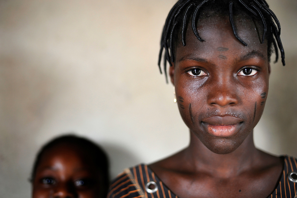 Woman with scarifications on her face. Scarification is used as a form of initiation into adulthood, beauty and a sign of a village, tribe, and clan in Cotonou, Benin March 01, 2008.