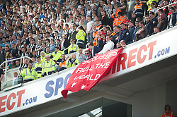 NEWCASTLE-UPON-TYNE, ENGLAND - Sunday, April 1, 2012: Liverpool supporters' banner 'Scousers Rule the World' during the Premiership match against Newcastle United at St James' Park. (Pic by David Rawcliffe/Propaganda)