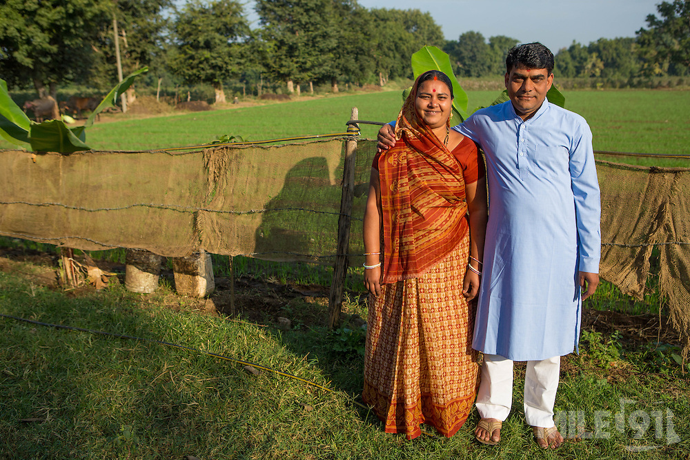 Shantilal and Maya outside their home, Madhya Pradesh, India.