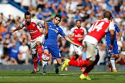 Francis Coquelin of Arsenal and Oscar of Chelsea compete for the ball - Mandatory byline: Rogan Thomson/JMP - 07966 386802 - 19/09/2015 - FOOTBALL - Stamford Bridge Stadium - London, England - Chelsea v Arsenal - Barclays Premier League.