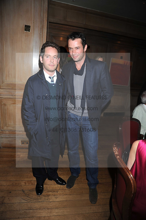 Left to right,TOM HOLLANDER and JAMES PUREFOY at a party to celebrate the launch of Hollywood Domino - a brand new board game, held at Mosimann's 11b West Halkin Street, London on 7th November 2008.  The evening was in aid of Charlize Theron's Africa Outreach Project.