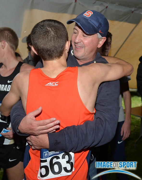 Nov 21, 2015; Louisville, KY, USA; Syracuse coach Chris Fox embraces Colin Bennie (563) after the Orangemen won the team title during the 2015 NCAA cross country championships at Tom Sawyer Park. Mandatory Credit: Kirby Lee-USA TODAY Sports
