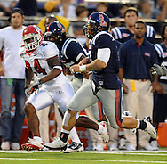 Mississippi quarterback Jeremiah Masoli (8) is chased by Fresno State's Desia Dunn (24) during an NCAA college football game at Vaught-Hemingway Stadium in Oxford, Miss. on Saturday, Sept. 25, 2010. (AP Photo/Oxford Eagle, Bruce Newman)  ** MAGS OUT, NO SALES, MANDATORY CREDIT **