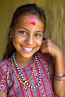Portrait of a young girl wearing a tika in a rural village in the Terai region of Nepal