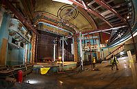 The main floor of the Colonial Theater with the final steel bar joists being removed by John Lavin of EniroVantage revealing a partial view of the grand drape hanging above the stage.   (Karen Bobotas/for the Laconia Daily Sun)